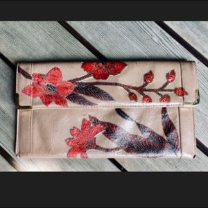 Genuine leather floral clutch